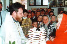 Parishioners congratulate Father Valeriy and present a cake